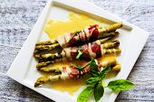 Asparagus - Grilled young asparagus wrapped in prosciutto meat and hollandaise sauce