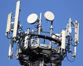 stock photo of wiretap  - cable and radar and antennas for signal repetition of mobile telephony and television signals - JPG