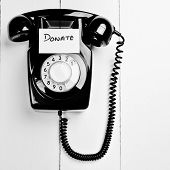 Retro Phone With A Note To Donate To Charity