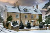 stock photo of broadway  - Detached Cotswold house with snow Broadway Worcestershire England - JPG