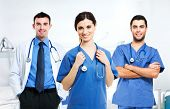 stock photo of nurse practitioner  - Portrait of a smiling nurse in front of her medical team - JPG