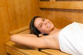image of sauna  - Beautiful woman relaxing in a sauna - JPG
