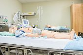 Medical dummies lying on hospital bed