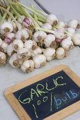 Garlic And Pricing Board At Farmers Market