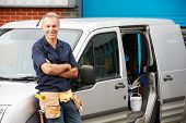 stock photo of plumber  - Plumber Or Electrician Standing Next To Van - JPG