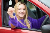 stock photo of rental agreement  - Teenage Girl Standing Next To Car Holding Key - JPG