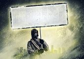 Image of stalker with blank banner against nuclear future