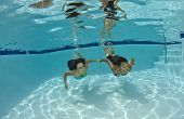 Friends Swimming Underwater