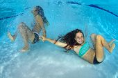 Girls Playing Underwater