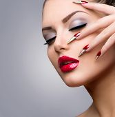 Fashion Beauty Model Girl. Manicure and Make-up. Sexy Red Lips and Nail art. Beautiful Woman With Long Nails and Luxury Makeup. Beautiful Girl Face and Hand