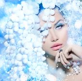 Winter Beauty. Beautiful Beautiful Fashion Model Girl with Snow Hair style and Make up. Holiday Make