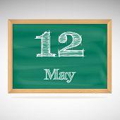 May 12, inscription in chalk on a blackboard