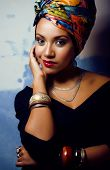 beauty bright african woman with creative make up, shawl on head like cubian woman