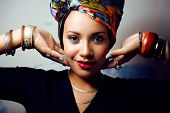 beautiful bright african woman with creative make up, scarf on head