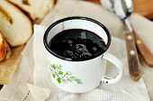 stock photo of chokeberry  - Chokeberry jam in a small metal mug - JPG