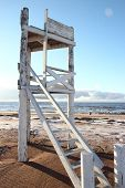 White wooden tower on the beach