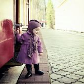 pic of child missing  - Little cute girl ready to vacation on railway station - JPG