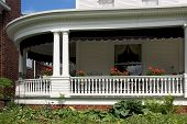 picture of wrap around porch  - large wrap around front porch with lots of detail work in the moldings and trim - JPG