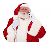 Grumpy Santa Clause taking a phone call. All on white background.