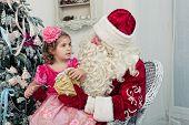 Girl in an elegant dress and Saint Nicolas