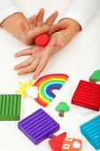 stock photo of molding clay  - Child playing with colorful clay molding different shapes  - JPG