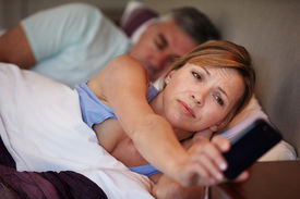 pic of early 50s  - Couple In Bed With Wife Suffering From Insomnia - JPG