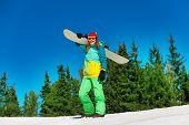 Snowboarder holding the snowboarder desk