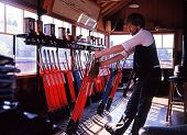 Man pulling levers in signal box, Bridnorth.