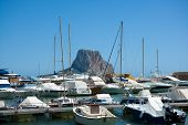 Calpe Alicante marina boats with Penon de Ifach mountain in Mediterranean sea of Spain