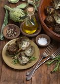picture of artichoke hearts  - Cooked and fresh artichokes with olive oil pepper and salt on the wooden table - JPG