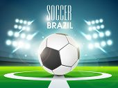 Shiny soccer ball in full stadium lights at night with stylish text brazil 2014.