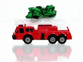 pic of fire truck  - Green bow on top a little red fire engine - JPG