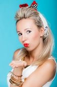 Portrait Beautiful Woman Pinup Girl Retro Style Blowing A Kiss - Flirty On Blue