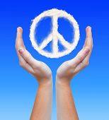 peace symbol from clouds in hands