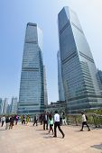 SHANGHAI, CHINA - APRIL 14, 2014: People on Shanghai Lujiazui flyover and buildings of Pudong New Ar