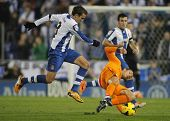 BARCELONA - JAN, 12: Cristiano Ronaldo(R) of Real Madrid vies with Stuani (L) of Espanyol  during th