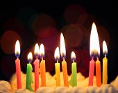 picture of candle flame  - Some lit color birthday candles close up