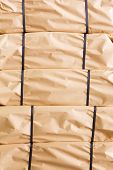 Stack Of Parcel Wrapped In Brown Recycled Paper