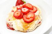 Fresh Sliced Berries On Top Of Hotcakes
