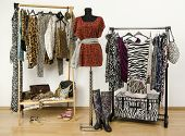 stock photo of wardrobe  - Red cheetah print outfit on a mannequin - JPG