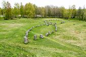 stock photo of viking ship  - Large stone ship made of raised stones in Anundshog Sweden - JPG