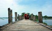 Mandalay, Myanmar - Oct 9: Unidentified Young Monks Walking On U Bein Bridge, Myanmar