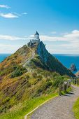 Lighthouse on Nugget Point. It is located in the Catlins area on the Southern Coast of New Zealand,