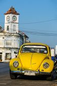 PHUKET TOWN, THAILAND - March 3: A retro Volkswagen car parked outside of the Promthep Clock Tower o