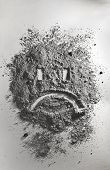 Sad Emoticon Made Of Ash