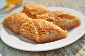 Turkish sweet pastry baklava on a plate closeup
