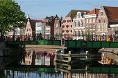 Haarlem Embankment On A Sunny Day With A View Of The Bridge