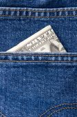 Two Dollar In Pocket Of Blue Jeans