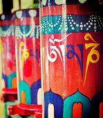 Vintage retro effect filtered hipster style travel image of Buddhist prayer wheels. Tsuglagkhang com