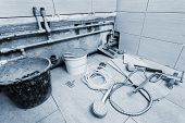 different tools for repair in the bathroom